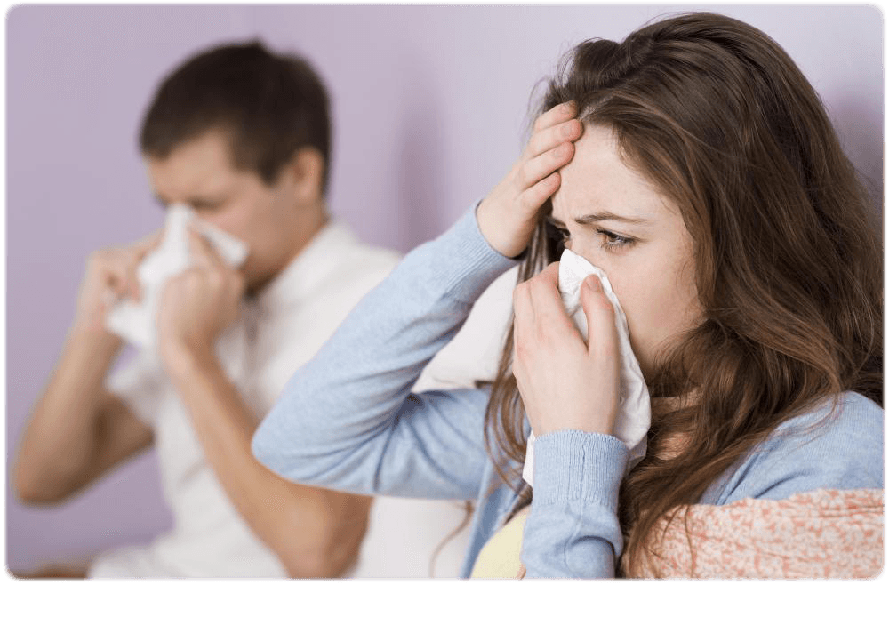 man-and-woman-sneezing